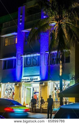 People Enjoy Nightlife And Go Shopping At Ocean Drive By Night