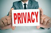 picture of private investigator  - a man wearing a suit showing a signboard with the text privacy written in it - JPG