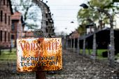 stock photo of auschwitz  - Warning sign in the former concentration and extermination camp Auschwitz - JPG