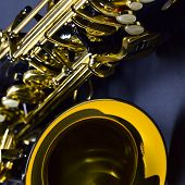 image of sax  - closeup of black saxophone focus on center