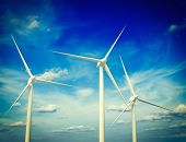 foto of turbines  - Vintage retro effect filtered hipster style image of green renewable energy concept  - JPG