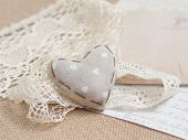 stock photo of shabby chic  - Shabby chic heart on vintage lace - JPG