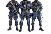 foto of anti-terrorism  - Special weapons and tactics SWAT team officers with guns - JPG