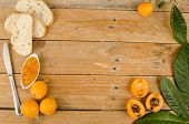 stock photo of loquat  - Still life with freshly harvested loquats and homemade marmalade - JPG