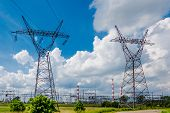 stock photo of power transmission lines  - Pylon And Transmission Power Line In Summer Day - JPG