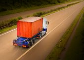 foto of fuel economy  - Container truck on the highway - JPG