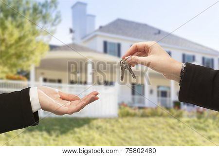 Handing Over The New House Keys with Home in the Background.