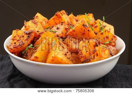 Fried potatoes with herbs and spices