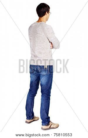 Full length half turn back view portrait of man in glasses and beige sweater with crossed arms on his chest isolated on white background