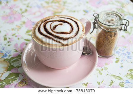 Hot Mocha Topping With Foamy Milk And Chocolate Sauce In Pink Cup