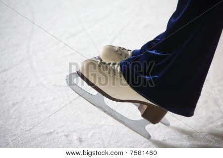 Human Feet In Fads Standing On Ice On The Brink Of An Edge