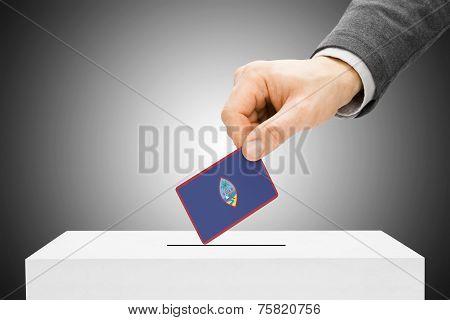 Voting Concept - Male Inserting Flag Into Ballot Box - Guam