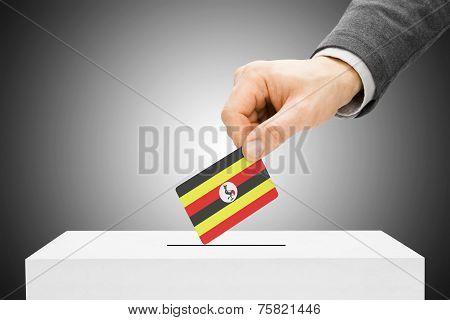 Voting Concept - Male Inserting Flag Into Ballot Box - Uganda