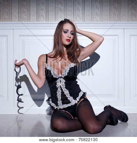 Sensual Woman In Lingerie Holding Handcuffs
