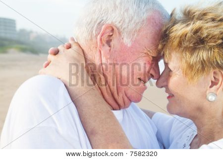 senior couple kissing outdoors