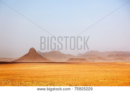 Arid peaks in a desertic landscape. Ouarzazate, Maroc, Africa.