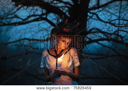 Young Girl In The Image Of A Bride With Lighted Candles In Their Hands