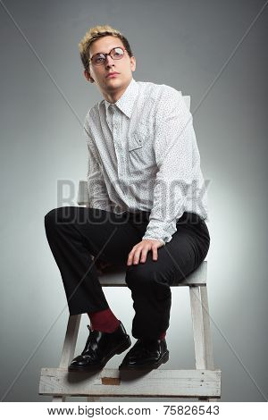 Young Businessman Looks Into The Distance In Career Ladder