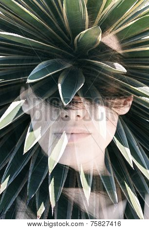 Double exposure portrait of attractive woman covering her face with hair combined with photograph of cactus