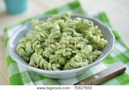 Fusilli pasta with spinach and ricotta cheese in a bowl