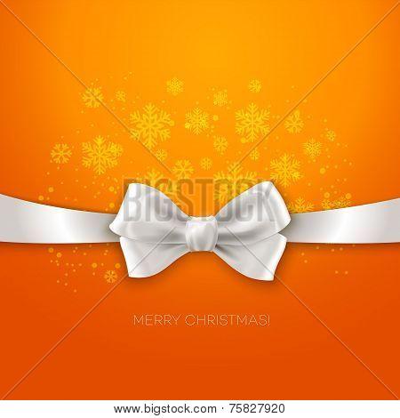 Orange Christmas background ribbon with white silk bow