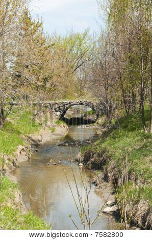 Stone Bridge Over Stream