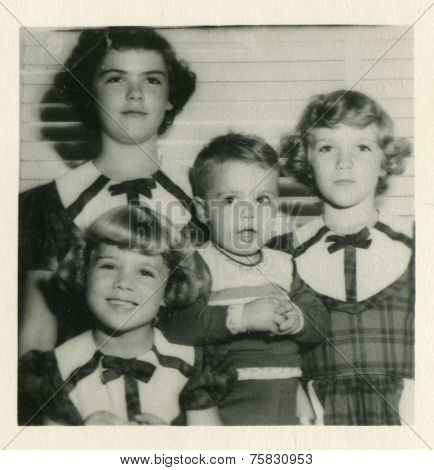 CANADA - CIRCA 1960s: Vintage photo shows group portrait of children.