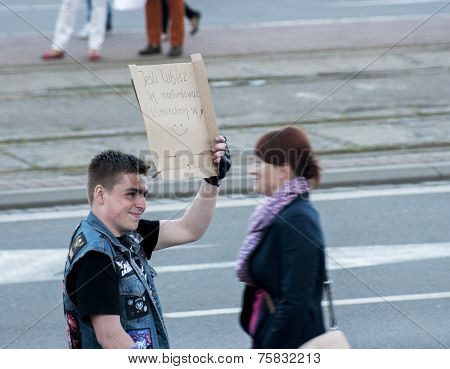 Young Man With Funny Banner