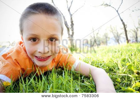 Little Boy Playing Outside