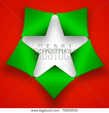 Shiny green torn paper in star shape with stylish text of Merry Christmas on bright red background.