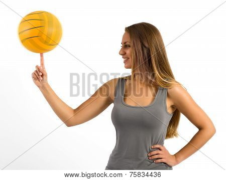 Young Woman Balancing A Ball On Her Finger