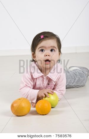 Attentive  Baby With Fruits