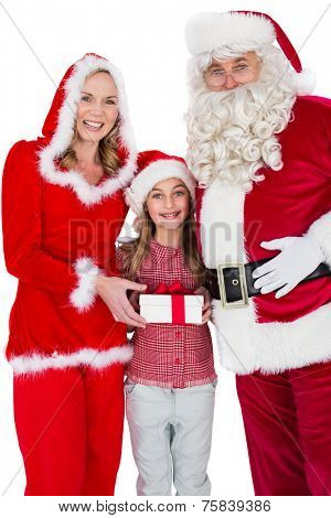 Santa and Mrs Claus smiling at camera with little girl on white background