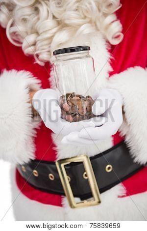 Santa holding jar full of pennies on white background