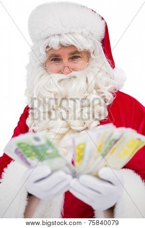 Happy santa claus showing his cash on white background