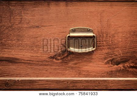 brass knob of an old chest of drawers