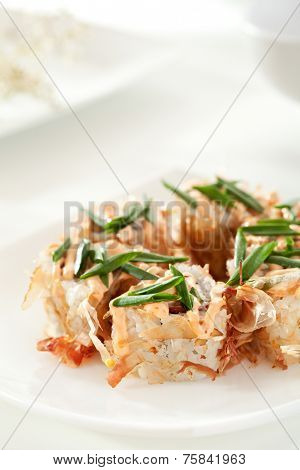 Bonito Maki Sushi - Rolls with Salmon, Cream Cheese and Tomato inside. Dried Shaved Bonito outside. Topped with Green Onions