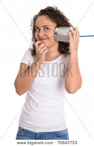 Funny young smiling girl listening on tin can phone.