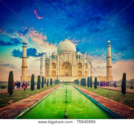 Vintage retro effect filtered hipster style image of  Taj Mahal on sunrise sunset, Indian Symbol - India travel background. Agra, Uttar Pradesh, India