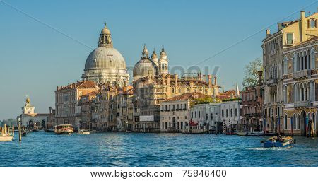 View looking down the Grand Canal of the Santa Maria della Salute, Venice with boat traffic on the water