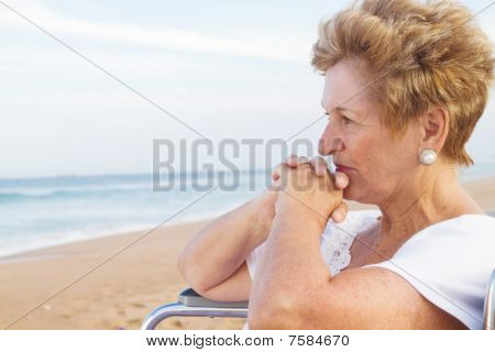 thoughtful senior woman in wheelchair