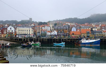 Fishing boat moors up in Scarborough harbour
