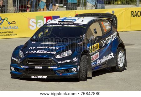 BARCELONA - OCT, 23: Miko Hirvonen of Finland and Jarmo Lehtinen of Finland in their FORD Fiesta RS during the Rally Catalunya-Costa Daurada  Spain on October 23, 2014 in Barcelona, Spainof the WRC