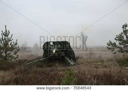 shot of artillery fire with flash