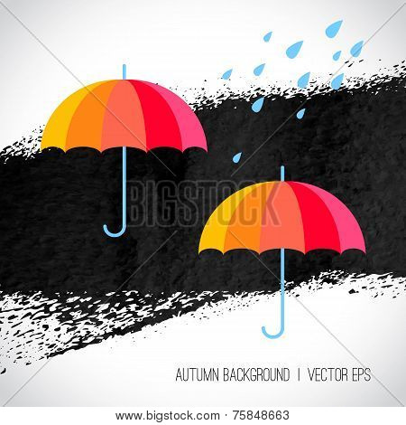 Autumn background. Rainbow color umbrellas and raindrops on blac