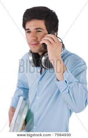 Male Student Calling With Mobile Phone Holding Books