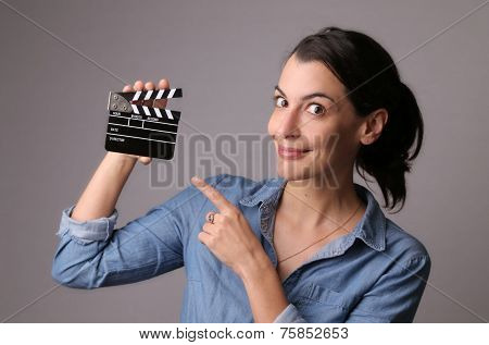 Woman Holding A Movie Clapper