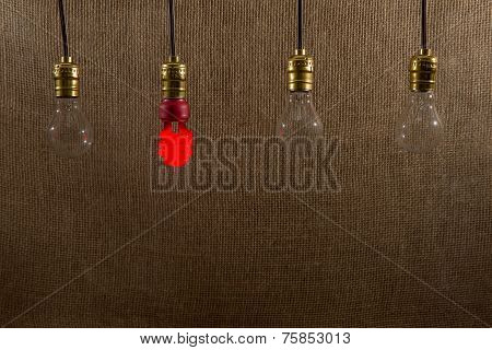 Hanging Red Cfl And Incandescent Bulbs