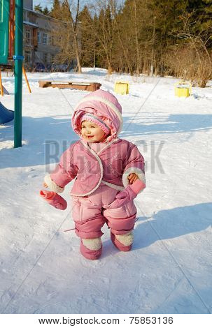 The Laughing Girl On A Children's Playground In The Winter