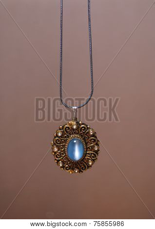 necklace with moonstone isolated in beige background